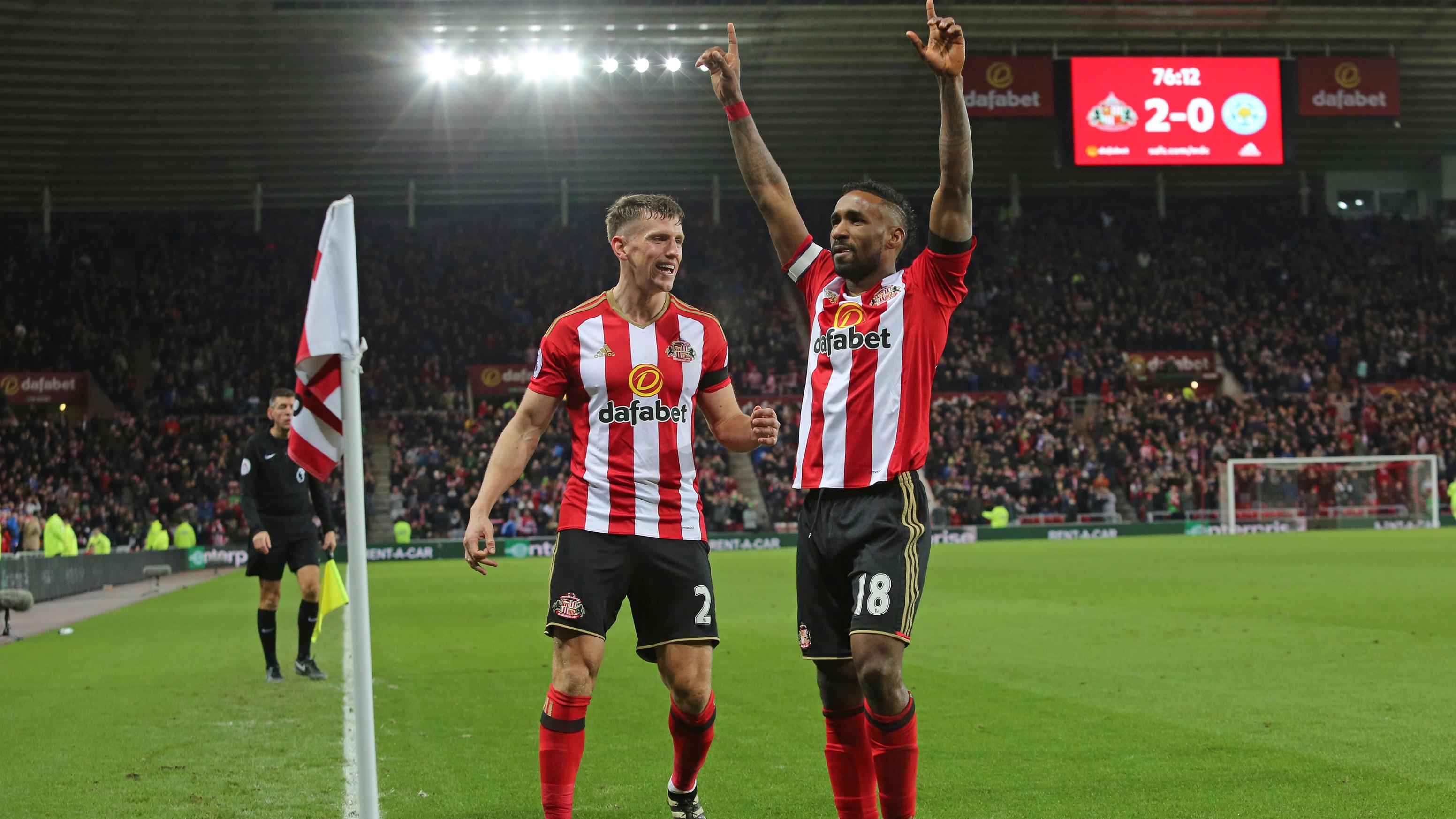 Jones and Defoe celebrate